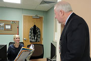 Mr. Devansky talks to employee Ms. Dianne Jacobs, Medical Support Assistant.