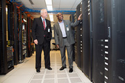 Paul Robinson, Facility Chief Information Officer, explains the new consolidated server room to Mr. Devansky.