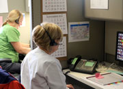 Registered nurses respond to phone calls in the triage call center.