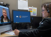 Veteran Richard Rauch talks remotely over VA Video Connect with a clinician in the VISN 4 tele urgent care clinic.