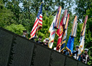The Joint Service Color Guard presents the colors at the Vietnam Veterans Memorial in Washington, D.C.