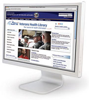 A computer monitor displays the Veterans Health Library website.