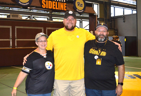 Two veterans posing for a photo with a Steelers player.